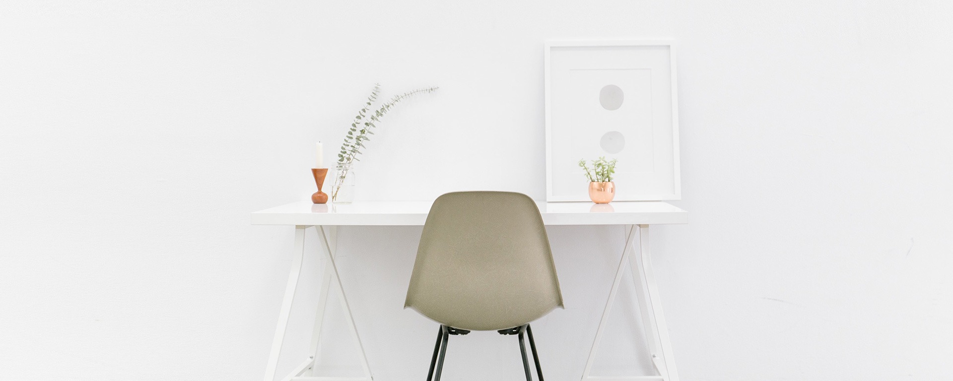 Chic chair and desk against a white wall.