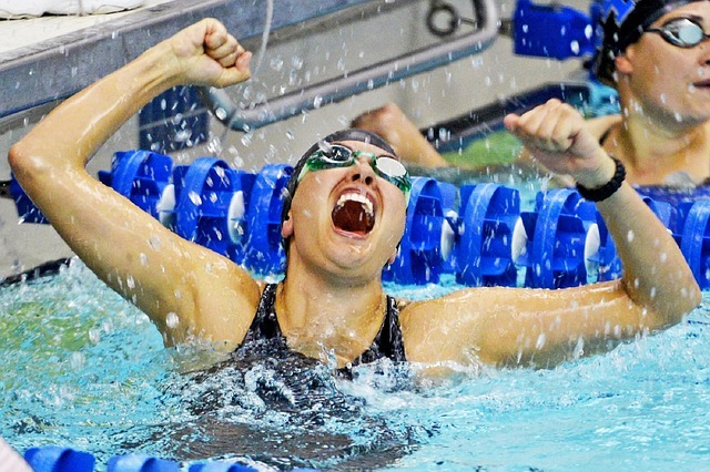 Excited swimmer winning the race