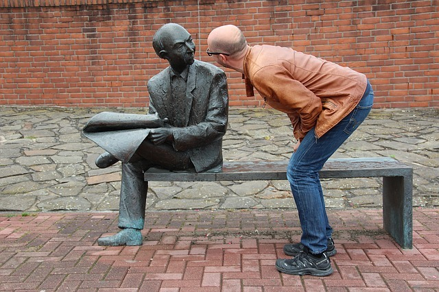 Man talking to a statue