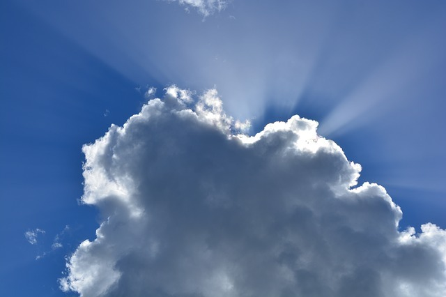 Cloud with silver lining against a blue sky.