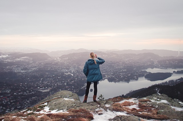Woman scratching her head while looking down from where she came from