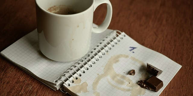 A notebook covered in coffee stains and chocolate
