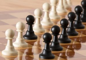 Chessboard with facing pawns