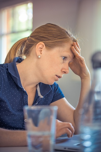 Stressed woman with a hand on her forehead