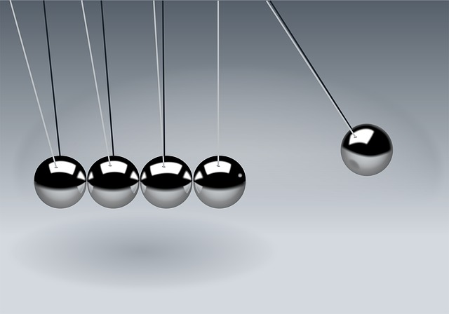 Close up of Newton's Cradle in action