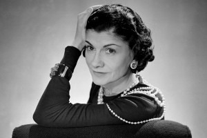 Black and white portrait of Coco Chanel reposing