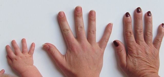 Three hands of different ages