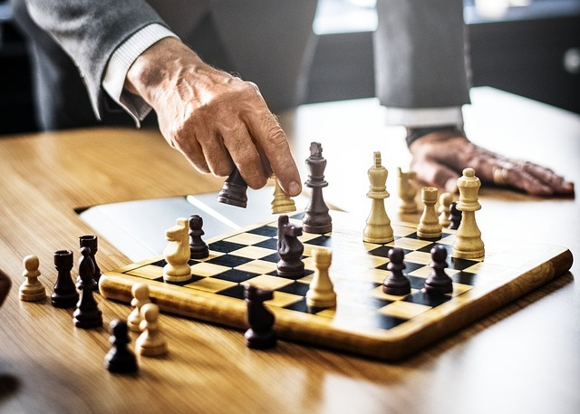 A guy in a suit playing chess