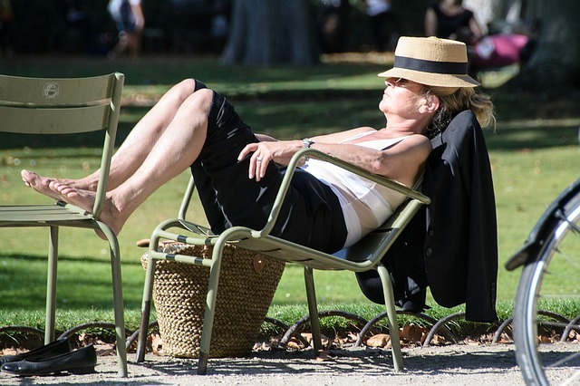 A businesswoman relaxing in the park
