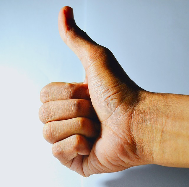 Thumbs up with a blue background