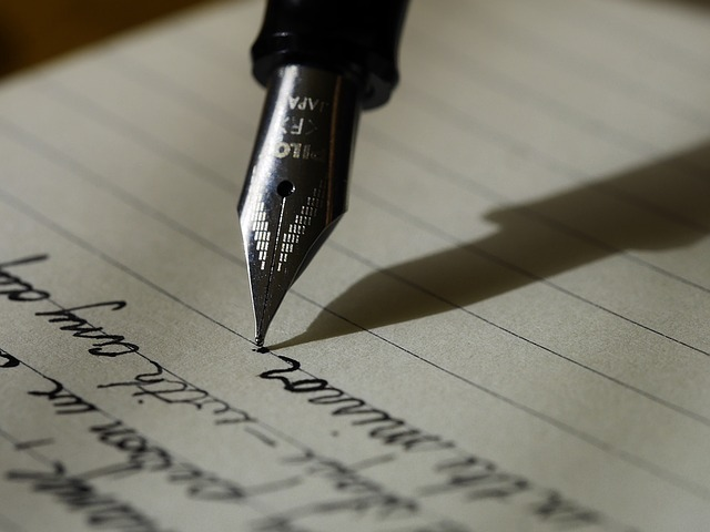 Writing with an ink pen on lined paper