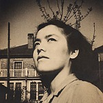 Portrait of Grace Lee Boggs looking upward