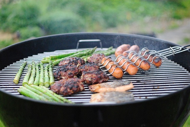 Barbeque of asparagus, burgers, and hotdogs