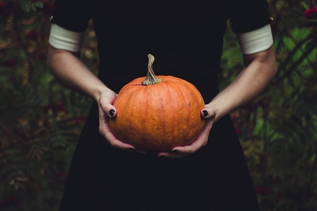 Person giving away a pumpkin