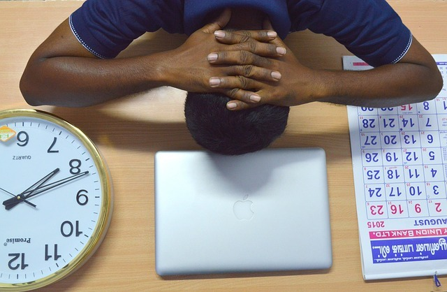Employee resting on his desk from stress
