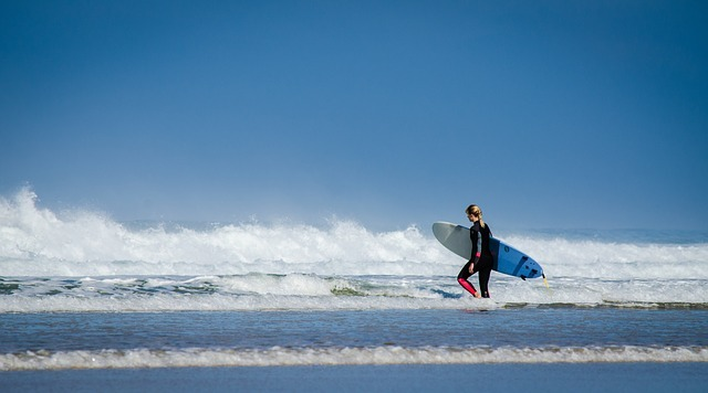 Woman approaches the surf