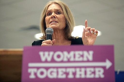 Gloria Steinem speaking at a podium
